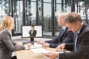 Business man Videochatting With Colleagues On Computer