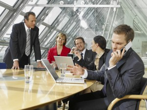 Five business executives in a board room