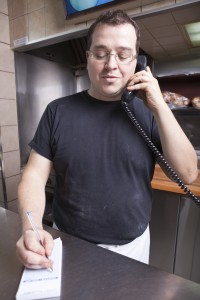 Restaurant owner taking food order to go